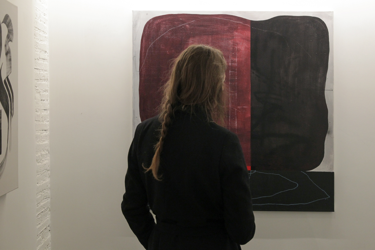 woman admires altrove exhibition abstractism